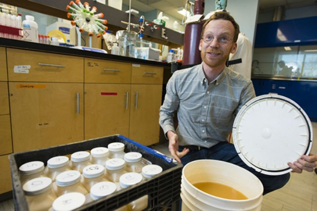 Dan Alessi, Encana Water Chair and assistant professor in Earth and Atmospheric Sciences, examines flowback water as part of a $2M study to examine best practices in hydraulic fracturing.