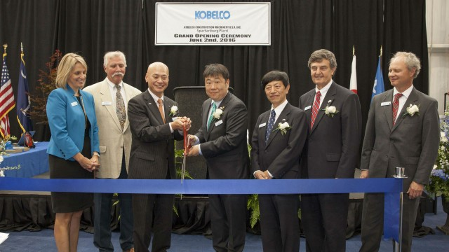 KOBELCO officials and special guests of the community participate in a ceremonial ribbon cutting.