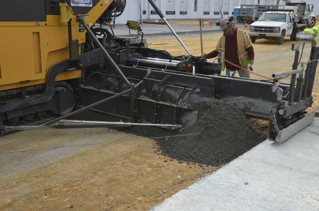 Utilizing the variable width screed and vibratory double tamping bar, the Volvo ABG7820C paver places the RCC concrete pavement quickly and efficiently.