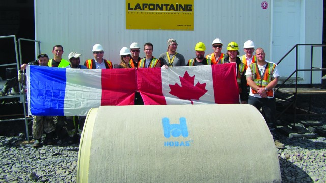 Company representatives show their support at the site of the project.