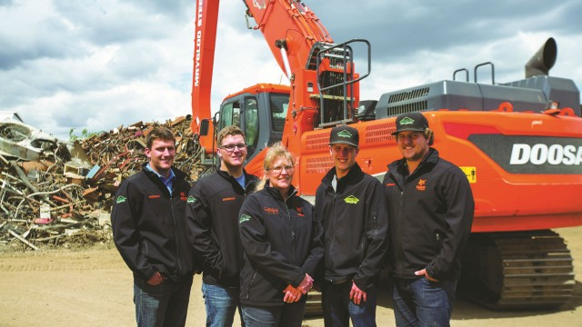 The Mryglod family at their yard in Weyburn, Saskatchewan, from left to right: Brad, Kyle, Sandra, Tyler and Travis.