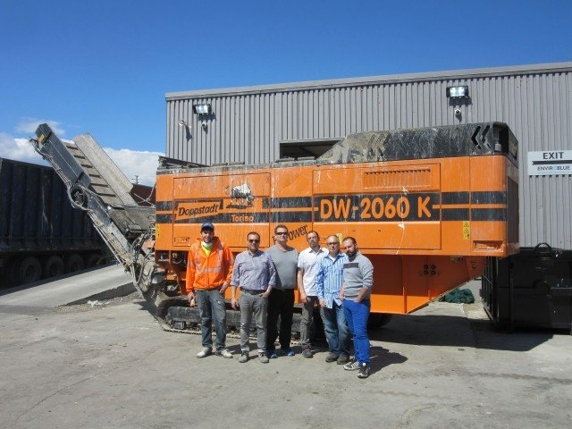 The crew at Enviro Blue Transfer and Recycling, near Toronto, with their Doppstadt SW 2060K BioPower shredder.