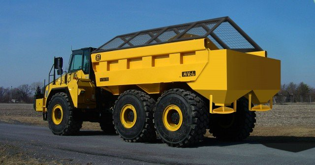 Haul truck operators can easily adjust material spread rate and width from the cab. The PHIL Material Spreader easily spreads road grit, sand or other material ranging in size from very fine to 2 inches.