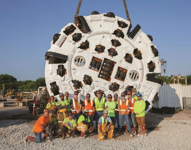 The S-K JV stands proudly in front of the cutterhead for the 6.2 m (20.2 ft) diameter Robbins TBM currently boring the DigIndy tunnels.