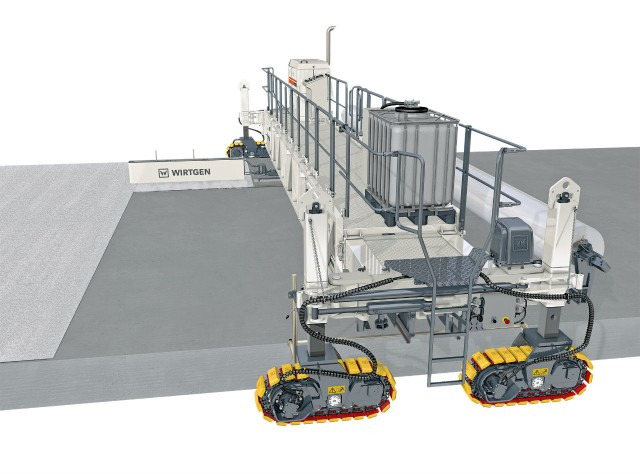 WIRTGEN TCM 180i SPRAY UNIT: Dispersion of curing moisture evaporation barrier is applied to the concrete in precisely metered quantities by the spraying unit on the transverse drive, preventing the concrete from drying prematurely. The desired surface texture is achieved by a broom unit, which is also mounted on the transverse drive.