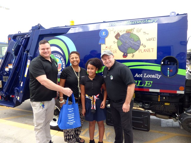A New Way Diamondback Rear Loader with the winning art-contest design from Barton Elementary School, Lake Worth, Florida.