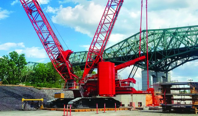 MLC650 crawler crane at work on the new Champlain Bridge, with the old bridge in the background.