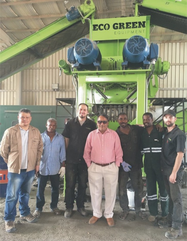 Uday Gautam, Manager of NRC (centre) and his team with their new ECO Green Giant two-shaft primary tire shredder system, along with ECO Green service technicians Ben Rogers (third from left) and Jarom Groat (far right).