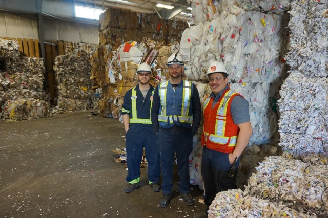 Inside the Loraas single-stream recycle plant, from left, Clayton Ludba, line supervisor, Dale Schmidt, recycle manager, and Ryan Divall, floor supervisor.