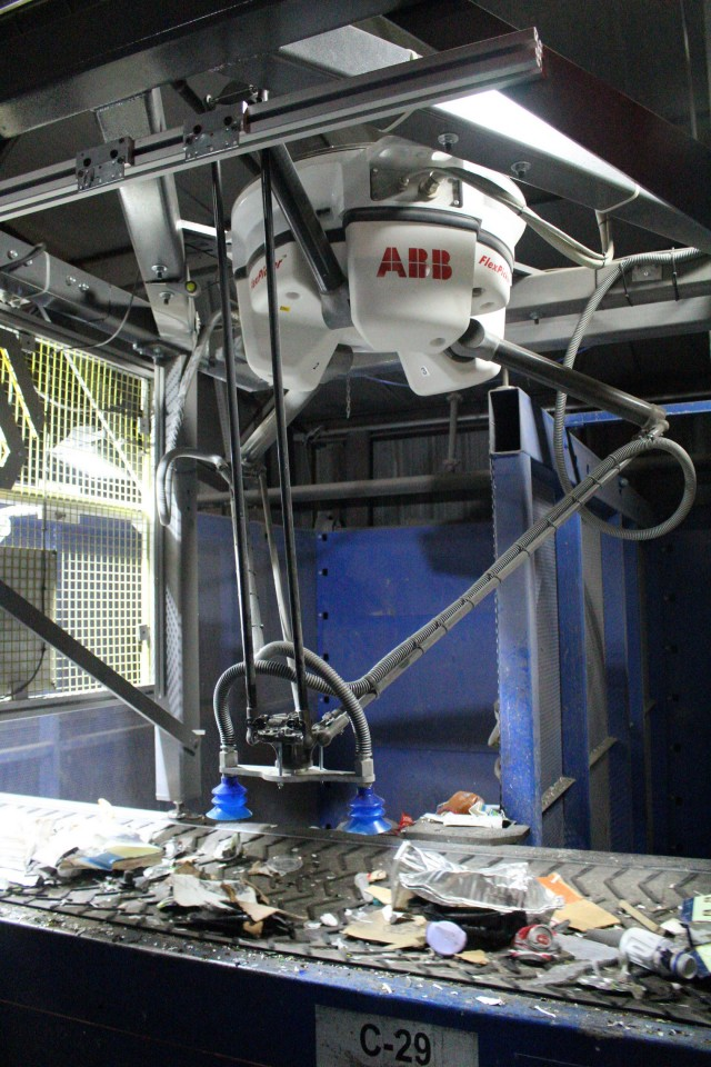 The AMP Cortex has spider-like arms with specially designed grippers to pick up and separate cartons at a materials recovery facility.