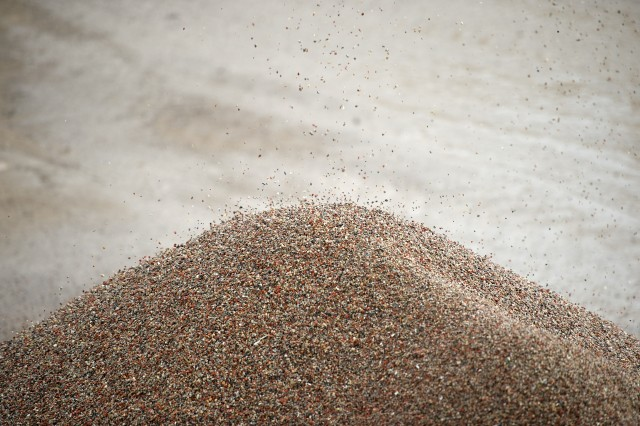 Recovered clean aggregate suitable for reuse in construction.