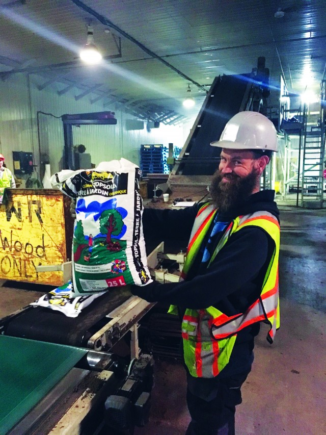 Rob Corcoran, plant operator, showing off Envirem Organics' high-quality, bagged product at the company's facility in Miramichi, New Brunswick.