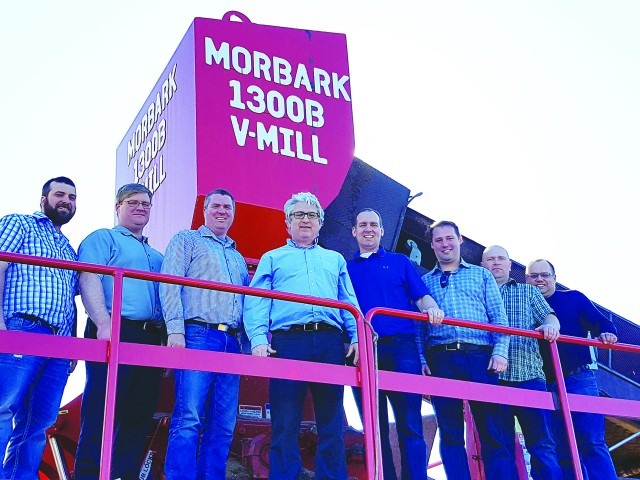 The Envirem Organics management team on their Morbark V-Mill grinder, from left: Matt Hebert, GM of Miramichi facility; Jim Barnet, operations manager, compost operations; JS Woods, manager of transportation & forestry division; Bob Kiely, president; Colin Murray, director of sales & marketing; Andrew Kimball, controller; Sheldon Russell, operations and QC superintendent, Miramichi facility; and Bryan Thorne, compliance & safety manager