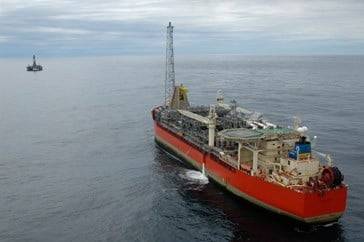 SeaRose FPSO with the GSF Grand Banks drilling rig in the distance