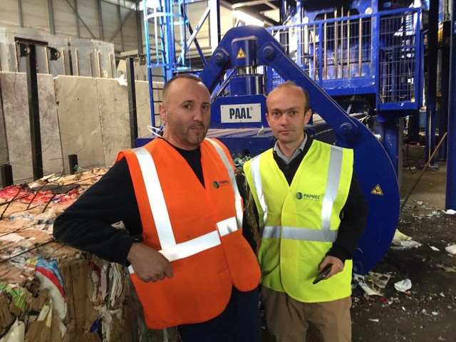 Ludovic Aberbour, COO, and Benjamin Tizon, Agency Director, Paprec Trivalo, Cote D'Azur in front of their new Kadant PAAL baler used for processing multi-materials continuously.