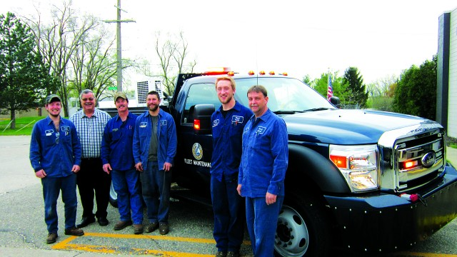 The public works crew is happy with their new VMAC UNDERHOOD air compressors which fit under the hood.