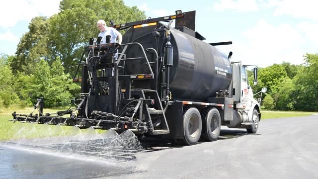 Updated sealcoating pumps for asphalt trucks