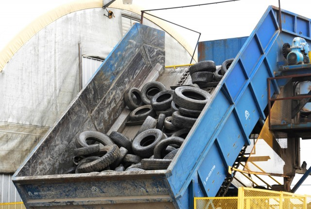 Tires waiting to be shredded at OTS recycled product manufacturer Moose Creek Tire Recycling.