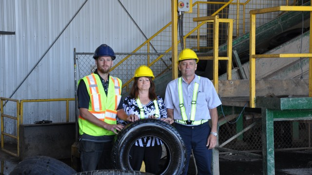 Halifax C&D Recycling vice-president Mike Chassie with his parents, company founders Lee-Anne and Dan Chassie, at the company's tire recycling facility.