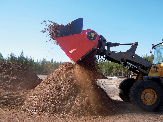 An Allu TS processing field bark. Allu's hydraulic attachments for wheel loaders, excavators and skid steers, will screen, crush, pulverize, aerate, blend, mix, separate and transform a wide range of materials in recycling, composting, construction, oil and gas and other applications.
