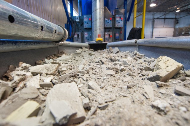 The sorting table where trash and metal pieces are removed from ceramic substrate before it goes to the crusher.