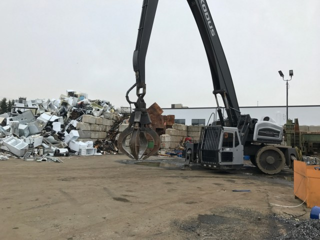 Davis Trading & Supply uses an Exodus scrap handler for loading, unloading and sorting ferrous materials.