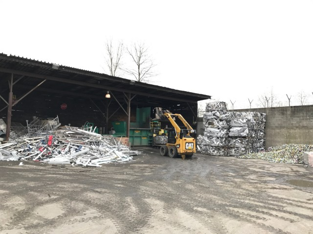 In the nonferrous baling area at Davis Trading & Supply, loading their Enterprise baler.