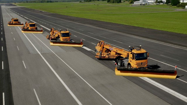 Automated Mercedes-Benz trucks take on airfield snow clearing in test operations