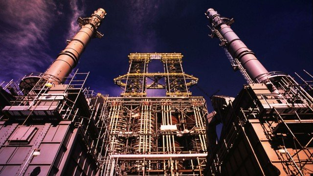 Coker towers at Suncor's oil sands plant; the company hopes to replace two coke-fired boilers with cogen facilities.