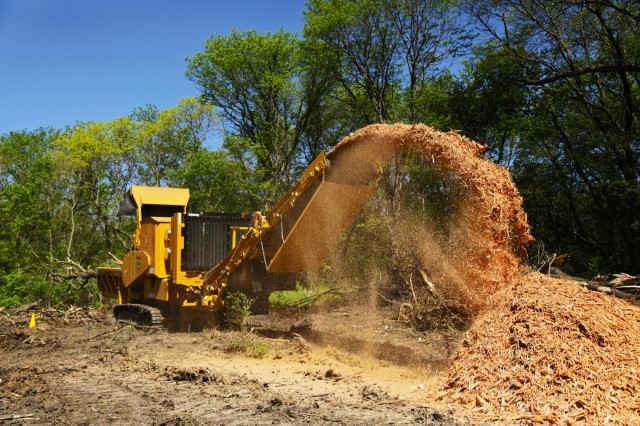 Vermeer's HG6800TX grinder on the job processing land clearing waste.