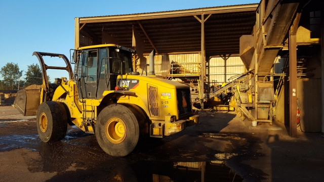 A Cat wheel loader on the job at Lane Forest Products.