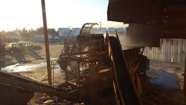 Loading the grinder at Lane Forest Products.
