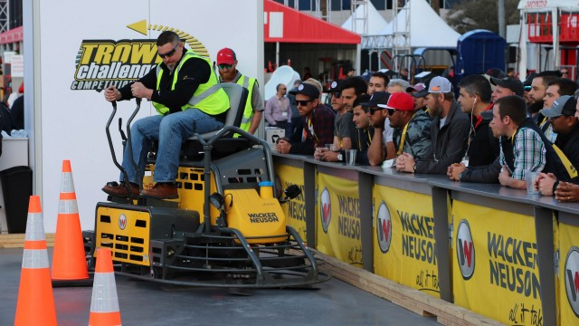 Derek Gromacki, PJ Dick, Inc., Pittsburgh, PA, navigates one of the tight turns at the 2018 Wacker Neuson Trowel Challenge. This year's course was reconfigured to show off the competitor's precision finishing skills as well as speed.