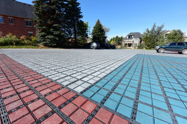 The redesigned parking lot and walking path at the King City Heritage and Cultural Centre incorporates a recycled rubber brick system to manage water runoff.