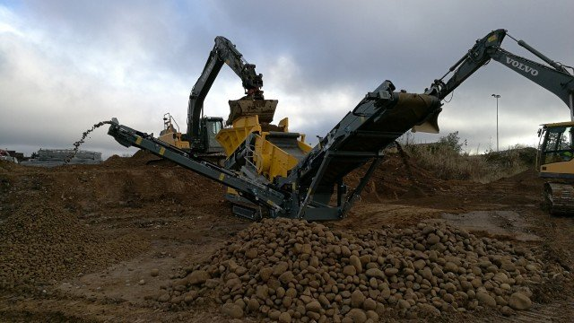The Rubble Master HS3500M compact tracked scalping screen.