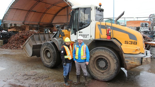 John Rai and Brett Matheson, at Richmond Steel Recycling's Mitchell Island yard with their Liebherr wheel loader.