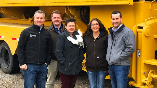 Part of the team at Homer Industries, with one of their TG9000 Vermeer tub grinders, from left: Todd Hahn, Chad Wallace, Kimberly Bell, Sam Elder and Josh Doherty.