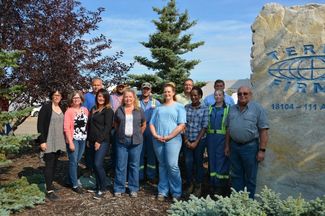 The Terrafirma team, from left to right: Amber Ford, Joan Mahoney, Don Proulx, Jacqueline LaFleur, Chad Ohlmann, Shirley Hamleuk, Shane Shackelton, Brianne Wood, Dave Rock, Chantal Nyangoma, Norbert Dieplinger (SBM), Desirae Hansen, and Erich Janke.