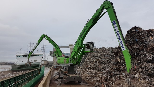 S. Norton & Co's two new SENNEBOGEN 870 M material handlers are seen loading scrap at the firm's Barking River Port.