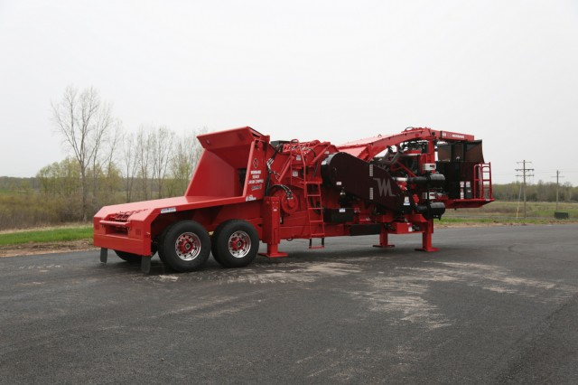 The 50/48X Whole Tree Drum Chipper was updated to a similar design layout as the Morbark's other industry-leading industrial drum chippers, with a sloped infeed, reverse-pivot top feed wheel, bottom feedwheel, and a range of other performance-enhancing features.