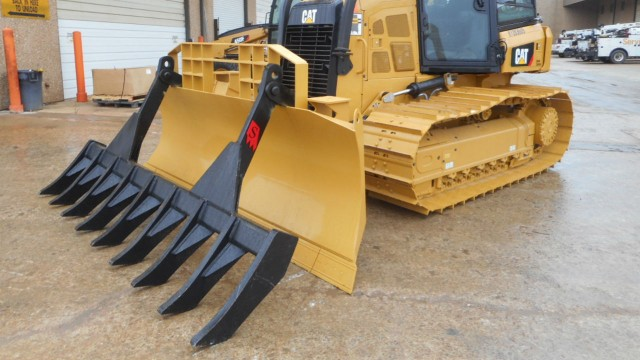 Solesbee's rakes fit most dozer blades without customization