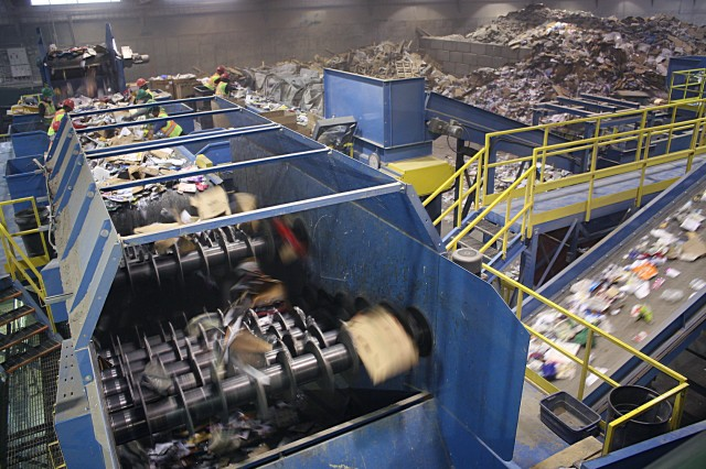 ECCO Recycling's Sparta in-line two-deck OCC screen, separating large OCC from other smaller (9-inch minus) materials. The larger OCC is carried over the top of the unit's disc screens and onto a 72-inch-wide baler feed conveyor, while the smaller fraction passes through the disc openings.