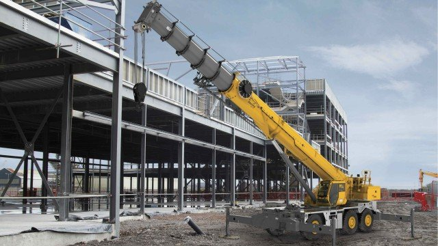 The new GRT9165 from Grove includes features demanded by customers. (Photo is not a true job site depiction. Crane has been added to a job site background. Crane is not configured in a true working condition and decals are not included.)
