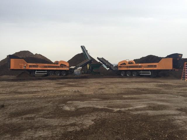 A pair of AK 630 Doppstadt grinders on site at Kreider Mulch.