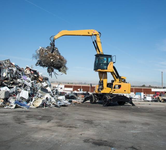 During the test demo at their Western Yard, SA Recycling's new MH3026, fitted with a one-yard Caterpillar four-tine grapple, was used primarily to unload trucks, move end-of-life vehicles, stockpile ferrous materials, and then sort and load materials for transfer to the shredder yard.