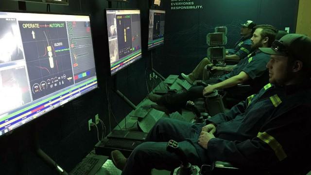 Operators of semi-autonomous underground equipment in the control room.