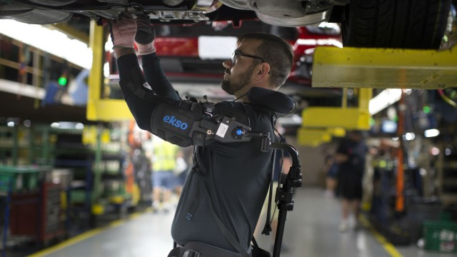 The EksoVest is helping take  strain off the overhead work that some Ford employees perform.