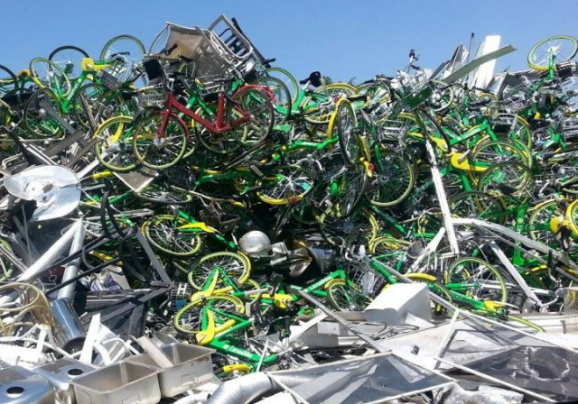 Lime Bikes piled high in a Denver scrap yard. Credit: Lime Bike Insider.