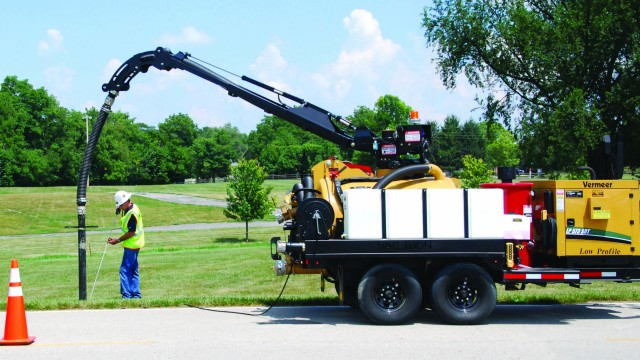 Vac-Tron's new hydraulic boom design provides easier operation on the company's trailer units.