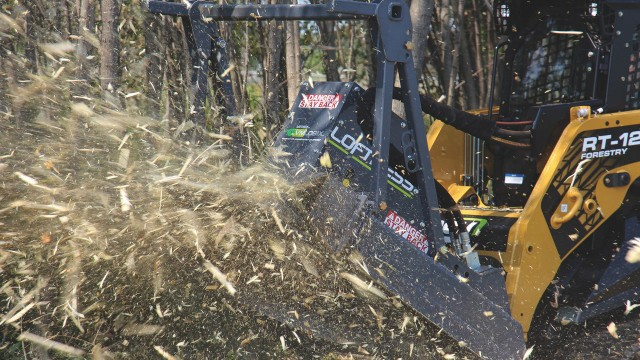 New Loftness disc mulcher for skid steers slices through vegetation like a Bad Ax